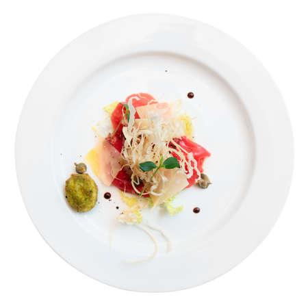 Tuna carpaccio on plate isolated over white background Stock Photo