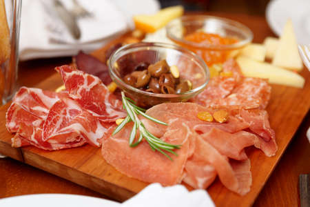 small plate: Meat snacks on a table, close-up Stock Photo