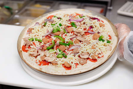 pizza maker: Pizza maker showing almost ready pizza reality shot