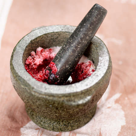 pestel: Salt and redberry marinade in granite mortar Stock Photo