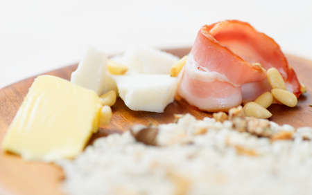 risotto: Risotto ingredients - bacon, butter, goat cheese, shallow focus Stock Photo
