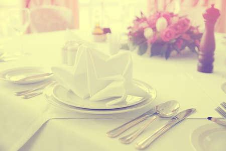haute cuisine: Table arrangement in an expensive haute cuisine restaurant, toned image