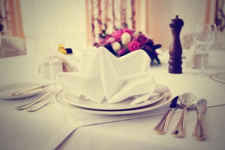 haute cuisine: Place setting in an expensive haute cuisine restaurant, toned image