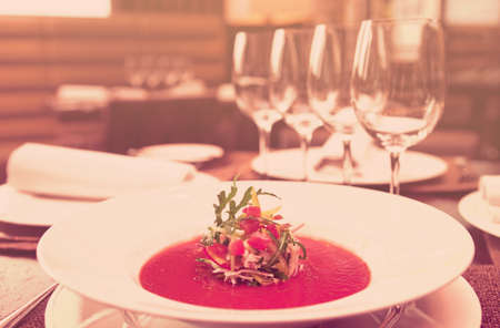 gaspacho: Soup on table in expensive restaurant, toned image
