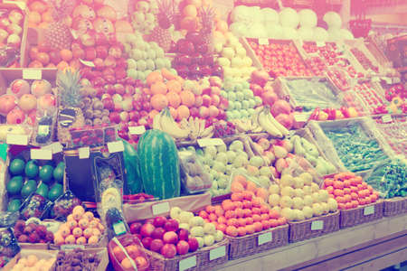 healthy choices: Shelf with fruits on a farm market, trademarks blurred or removed, toned image