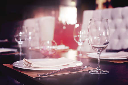 place setting: Place setting in a restaurant, shallow focus, toned image