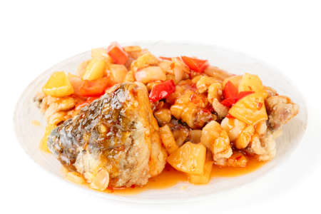 Deep fried carp in sweet-sour sauce, isolated on white photo