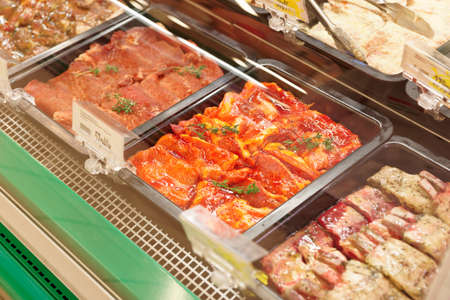 Meats in marinade on supermarket display