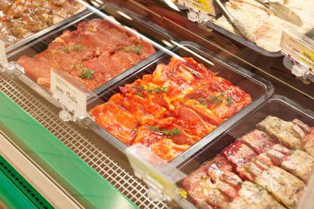 marinade: Meats in marinade on supermarket display