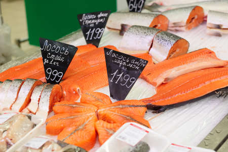 cooled: Salmon steaks on a cooled market display