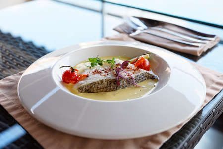 chilean: Chilean seabass fillet in plate on restraurant table
