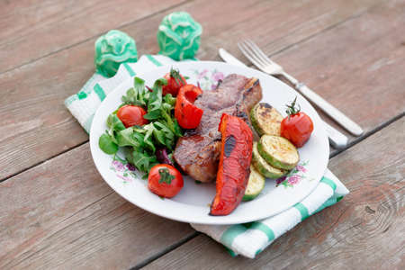 New York steak with vegetables shot outdoor photo