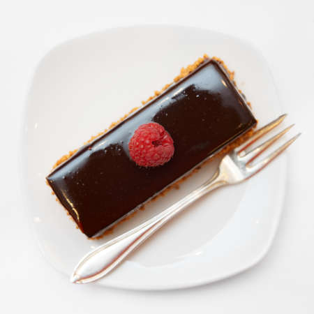 whitem: Piece of chocolate cake in small plate shot from above