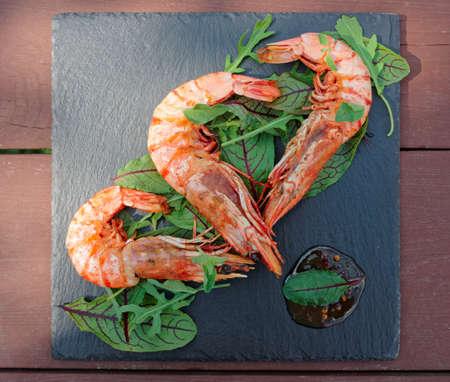jumbo shrimp: Grilled shrimps on slate plate Stock Photo