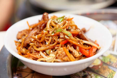 china cuisine: Noodles with soy sprouts and vegetables cooked in wok, typical asian food