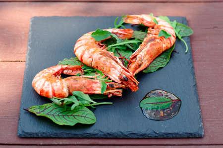 outdoor shot: Grilled shrimps on slate plate, outdoor shot