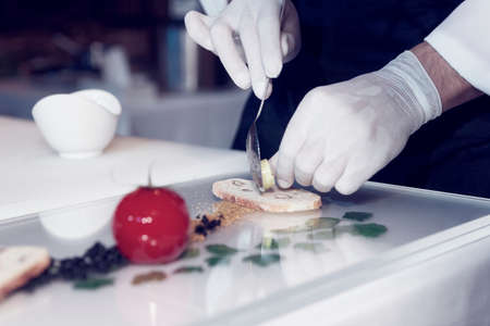 cuisine: Chef is cooking a gourmet dish, toned image