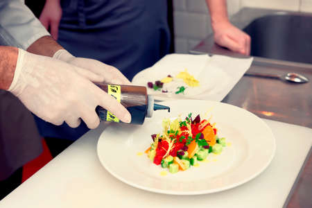garnish: Chef is cooking tuna appetizer, toned image