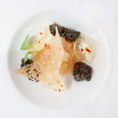 haute: Small gourmet dish with black caviar, close-up