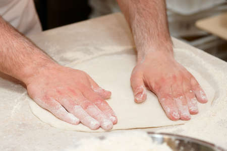 pizza maker: Chef is cooking pizza, forming dough