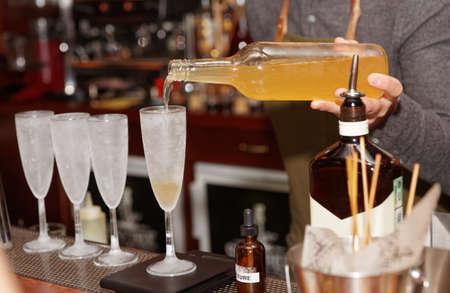 frozen glass: Bartender is pouring liquor in frozen glass