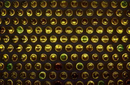 bottoms: Illuminated bottle bottoms, wall decoration, background Stock Photo