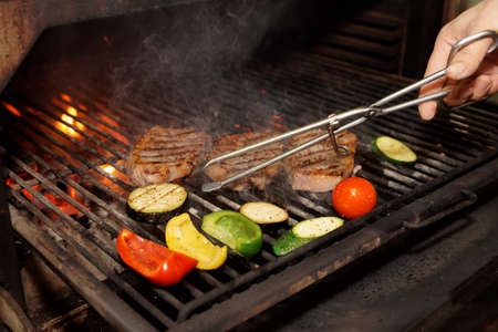 gril: Meat and vegetables on charcoal gril