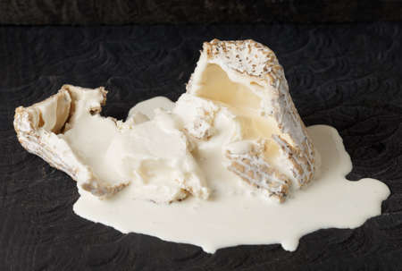 black mold: Goat cheese with mold and liquid milky substance inside