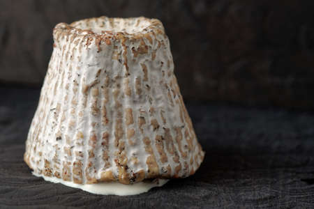 crust: Goat cheese with mold crust and milky substance inside Stock Photo