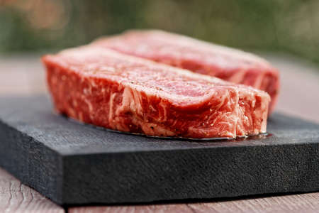 outdoor shot: Two pieces of raw striploin steak, outdoor shot, toned Stock Photo