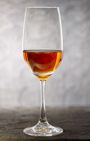 fortified: Glass of amontilliado sherry on a wooden plank