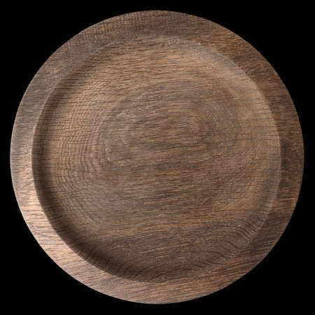 Round wooden plate shot from above isolated on black background Reklamní fotografie