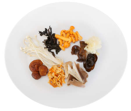 the fungus: Asian mushrooms on plate, isolated over white with clipping path