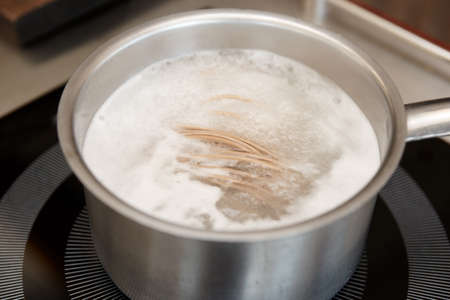 boiling: Buckwheat noodles being cooked in boiling water Stock Photo