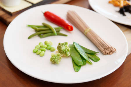 runner bean: Ingredients for a vegetarian dish on plate