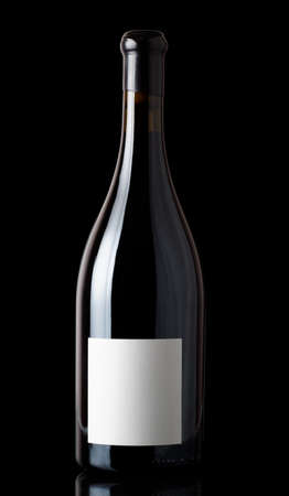 shiraz: Shiraz red wine in Burgundy style bottle, isolated on black Stock Photo
