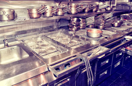 oven range: Typical kitchen of a restaurant shot in operation, toned image