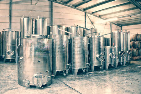 vats: Fermentation stainless steel vats in a winery, toned