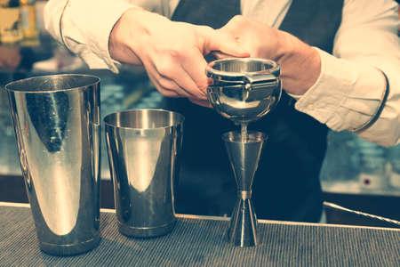 squeezing: Bartender is squeezing citrus juice, toned