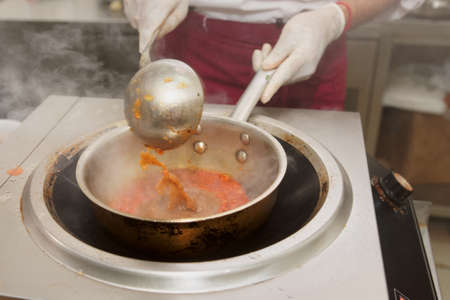 friture: Chef is stirring vegetable sauce in wok