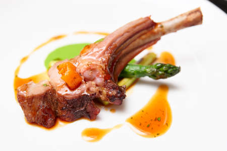 lamb: Rack of lamb on plate, close-up Stock Photo