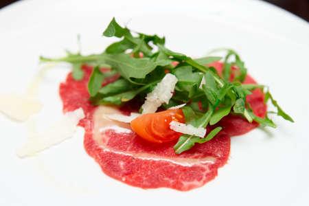 Small portion of beef capraccio close-up