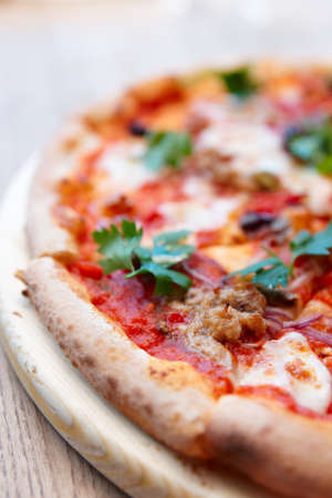 puttanesca: Pizza with meat and puttanesca sauce  close-up