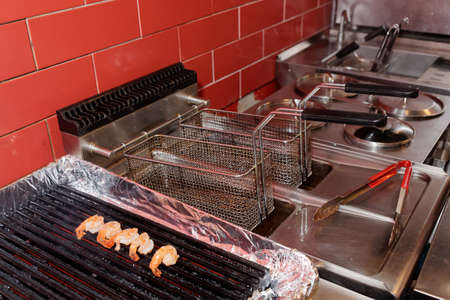 friture: Commercial kitchen equipment - grill and deep fryer Stock Photo