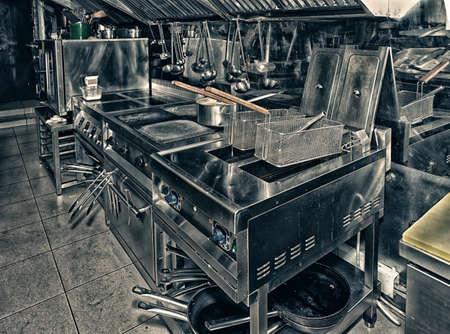 Typical and restaurant kitchen, toned image Banco de Imagens