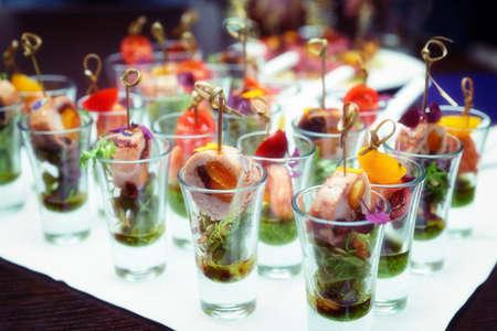shot glasses: Various snacks in shot glasses on table