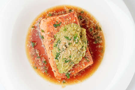 mash: Grilled salmon fillet with avocado mash shot from above