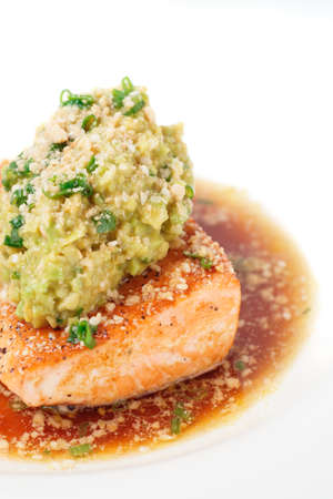mash: Grilled salmon fillet with avocado mash and savory sauce