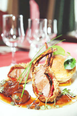 Rack of lamb with caramelized onions and homemade bun, toned Stock Photo