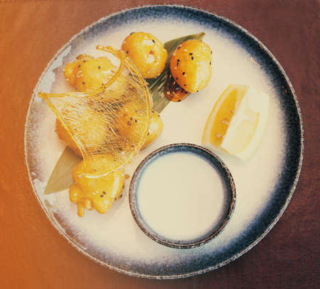 molted: Caramelized fruits in dough, chinese dessert, in plate